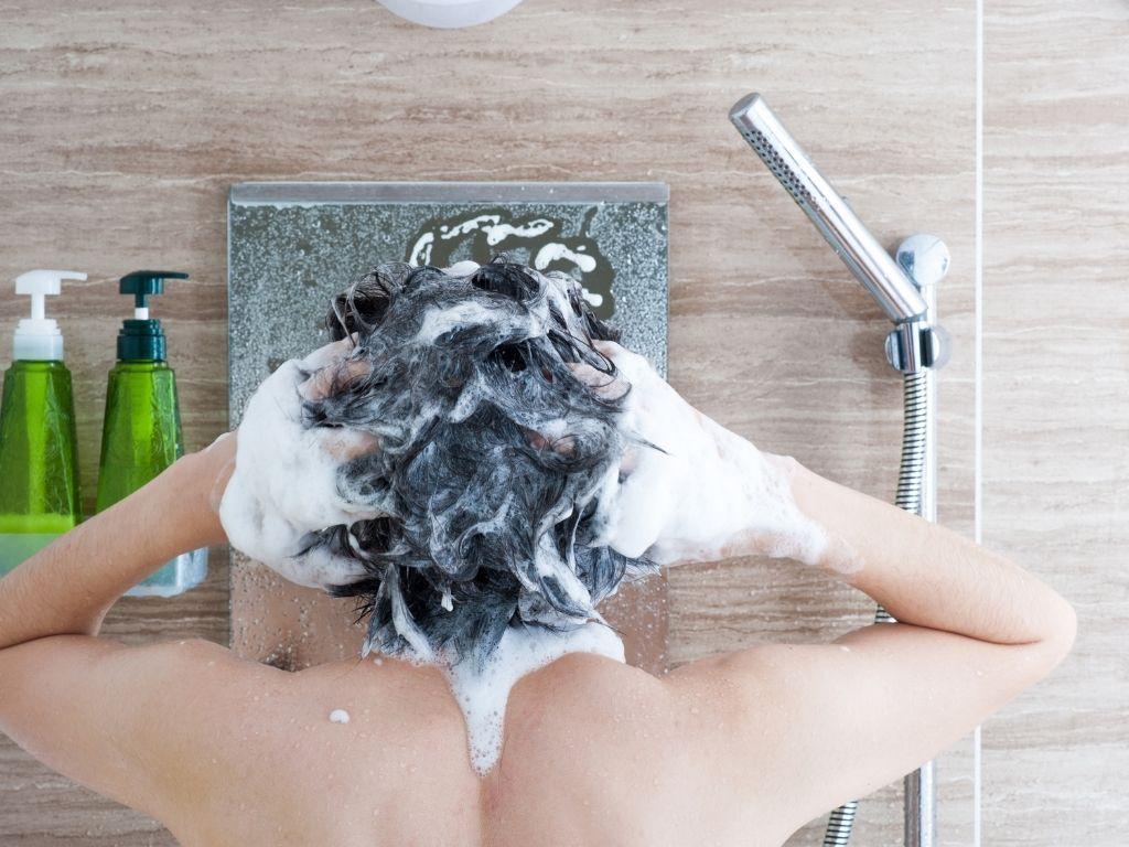 washing hair before straightening it